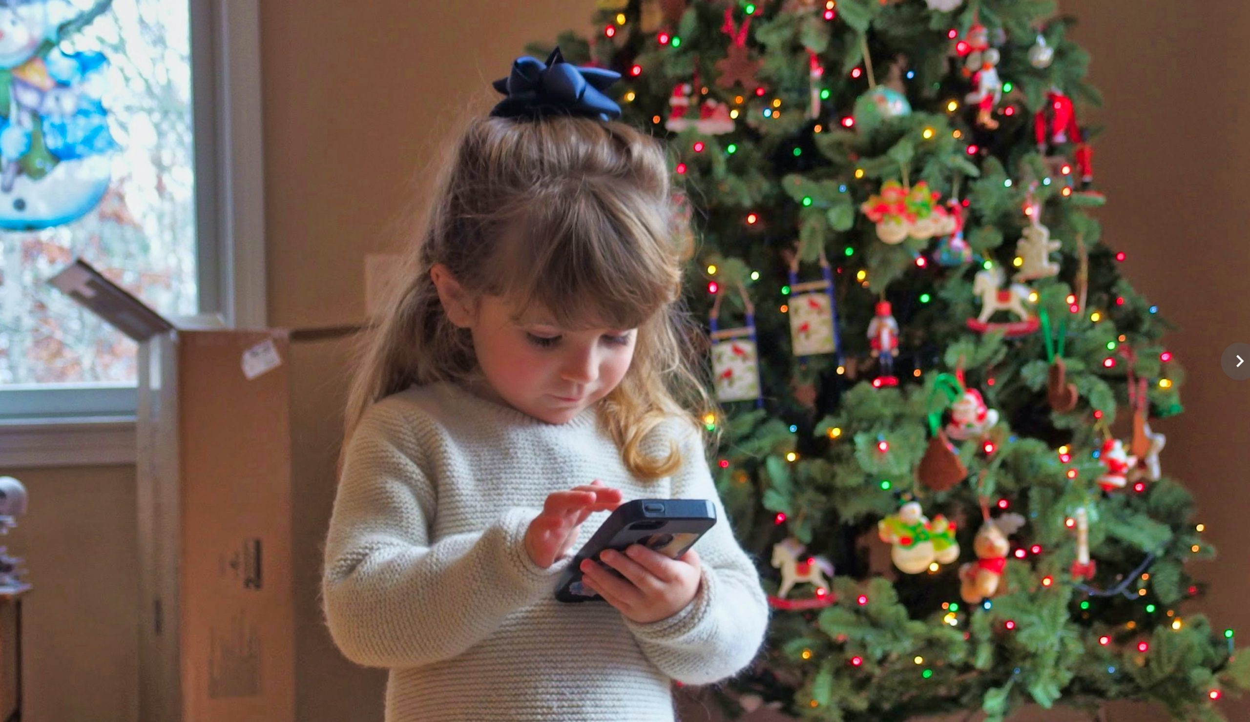 Child with iPhone at Christmas