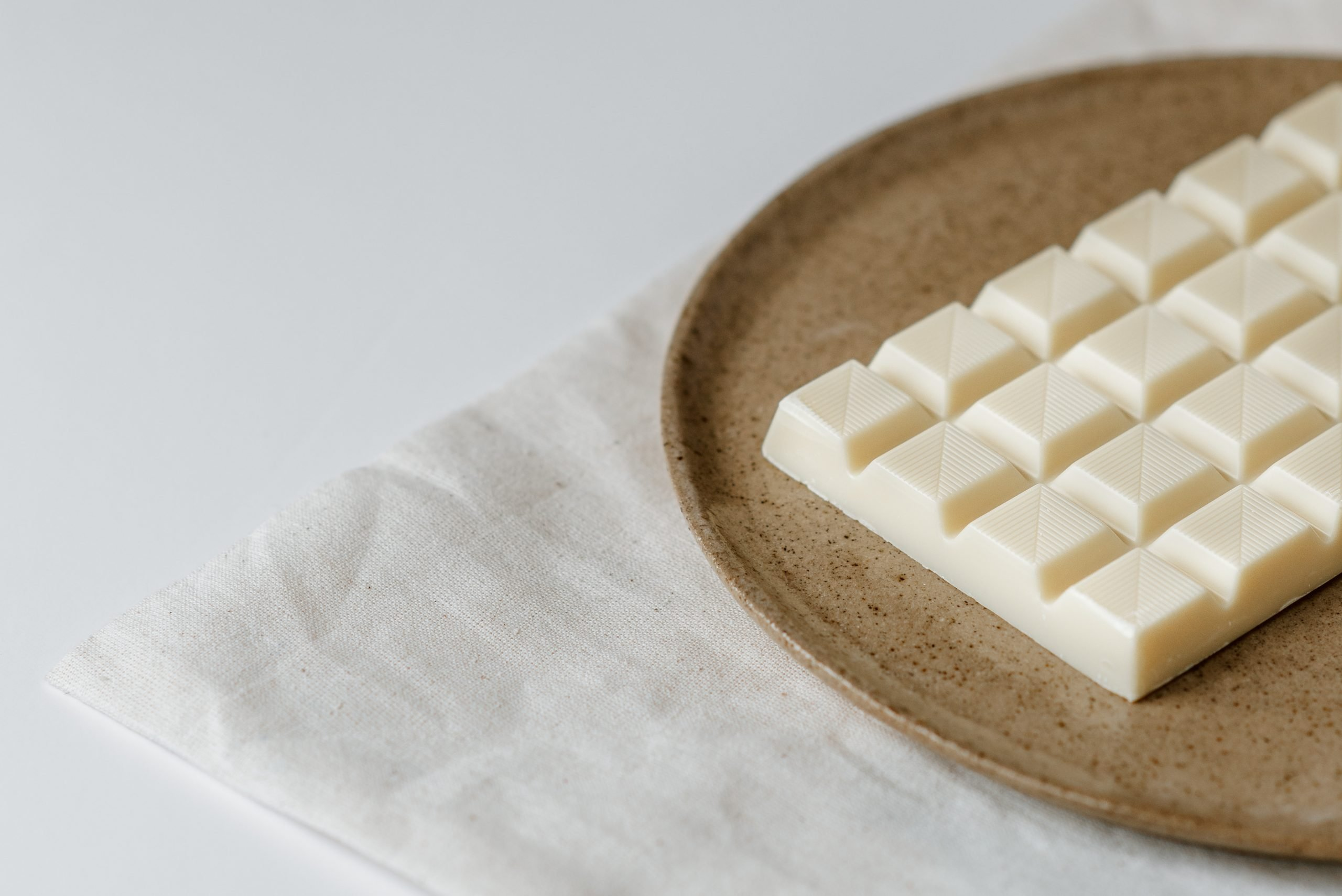 Delicious white chocolate on ceramic plate