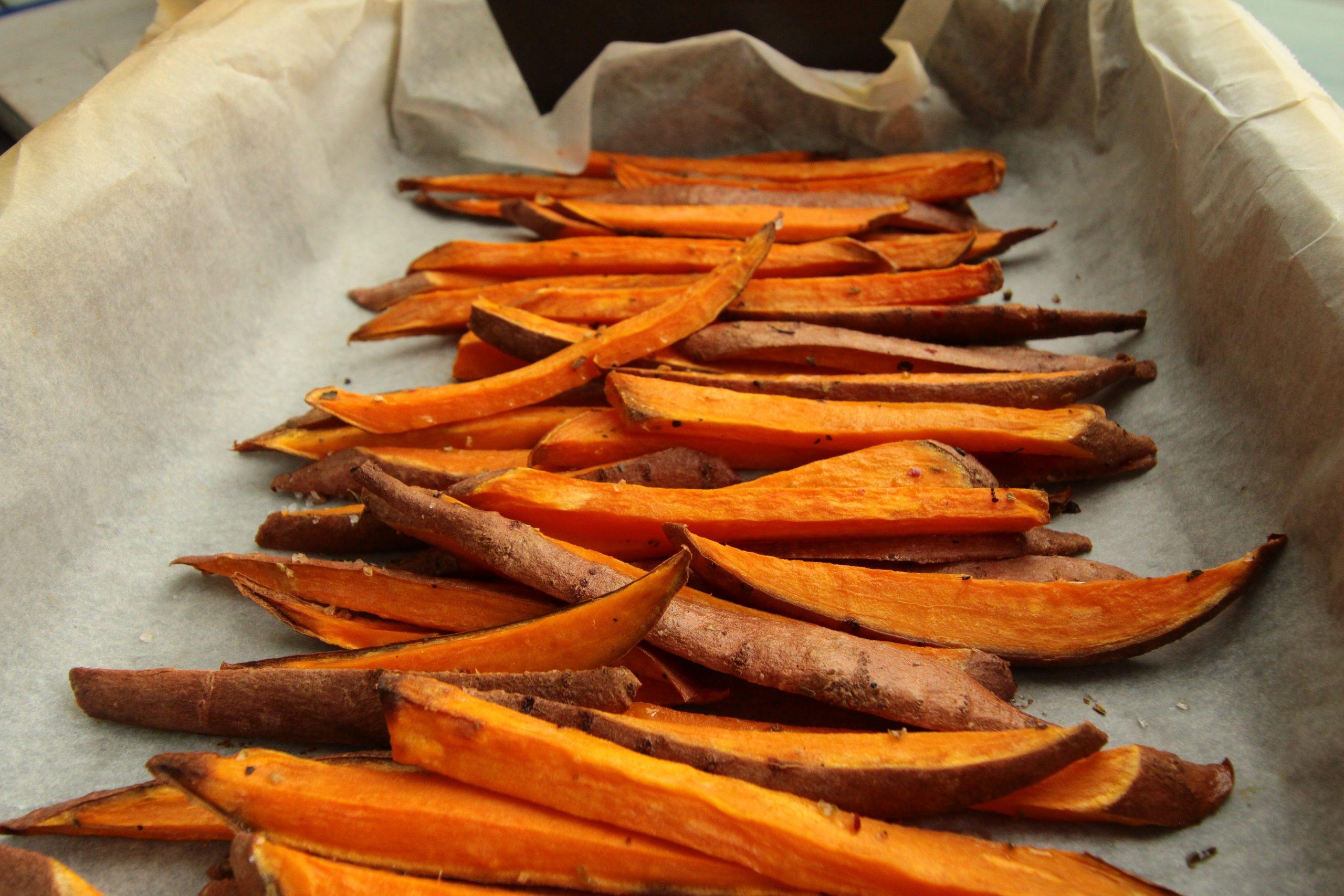 sliced carrots on white paper