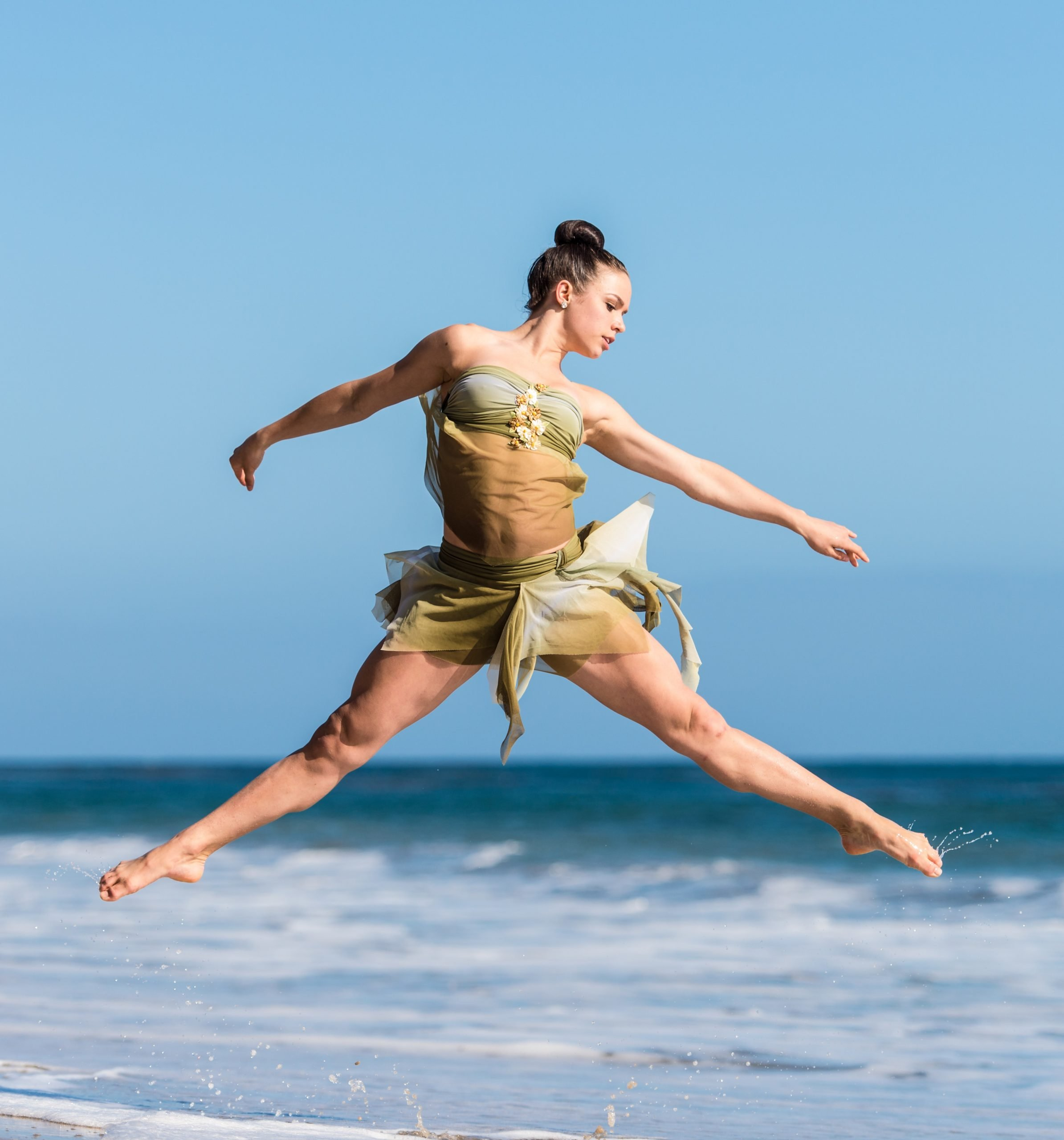 Dancer: Sydney Zmrzel Whenever I do a photo session with a dancer, I try to shoot some of our photos at the beach. California has some of the most beautiful beaches. Taking a dancer in their costume out of the studio and stage into the beautiful nature is one of my favorite things to do as a photographer. There is something magical about the ocean and I hope a hint of it will show up in my photos of these amazing dancers I get to work with.