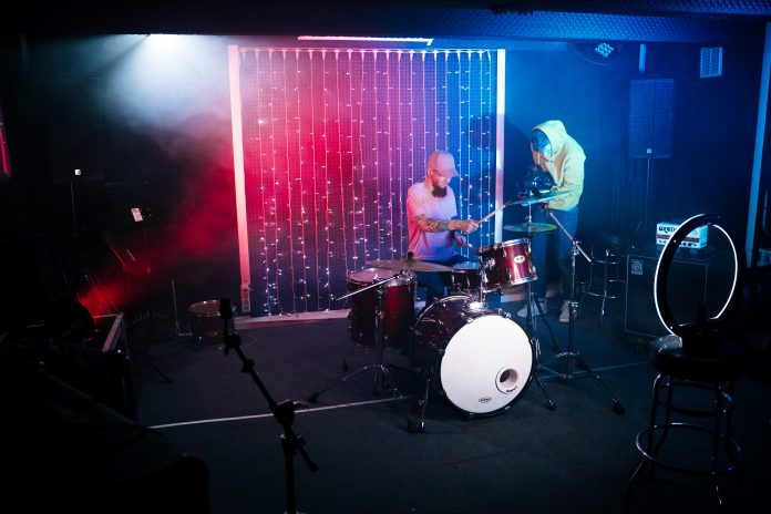 Filming a man playing the drums