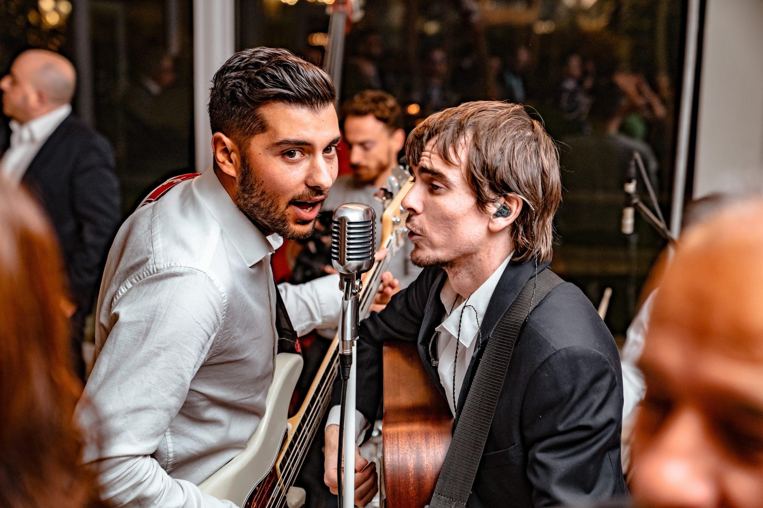 men playing guitar and singing