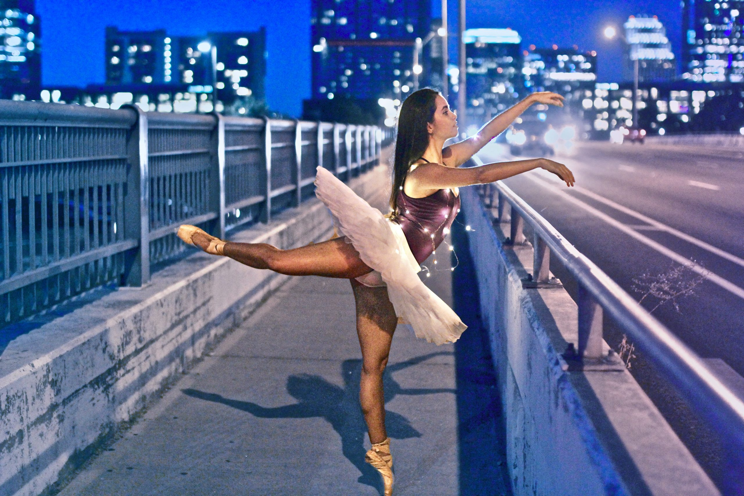 We had struggled all night to get a good capture of this one dance pose, but finally was able to catch the right moment for her to hold the pose and for oncoming cars to light her up in just the right way. Even though it took a while, the end result was worth it.