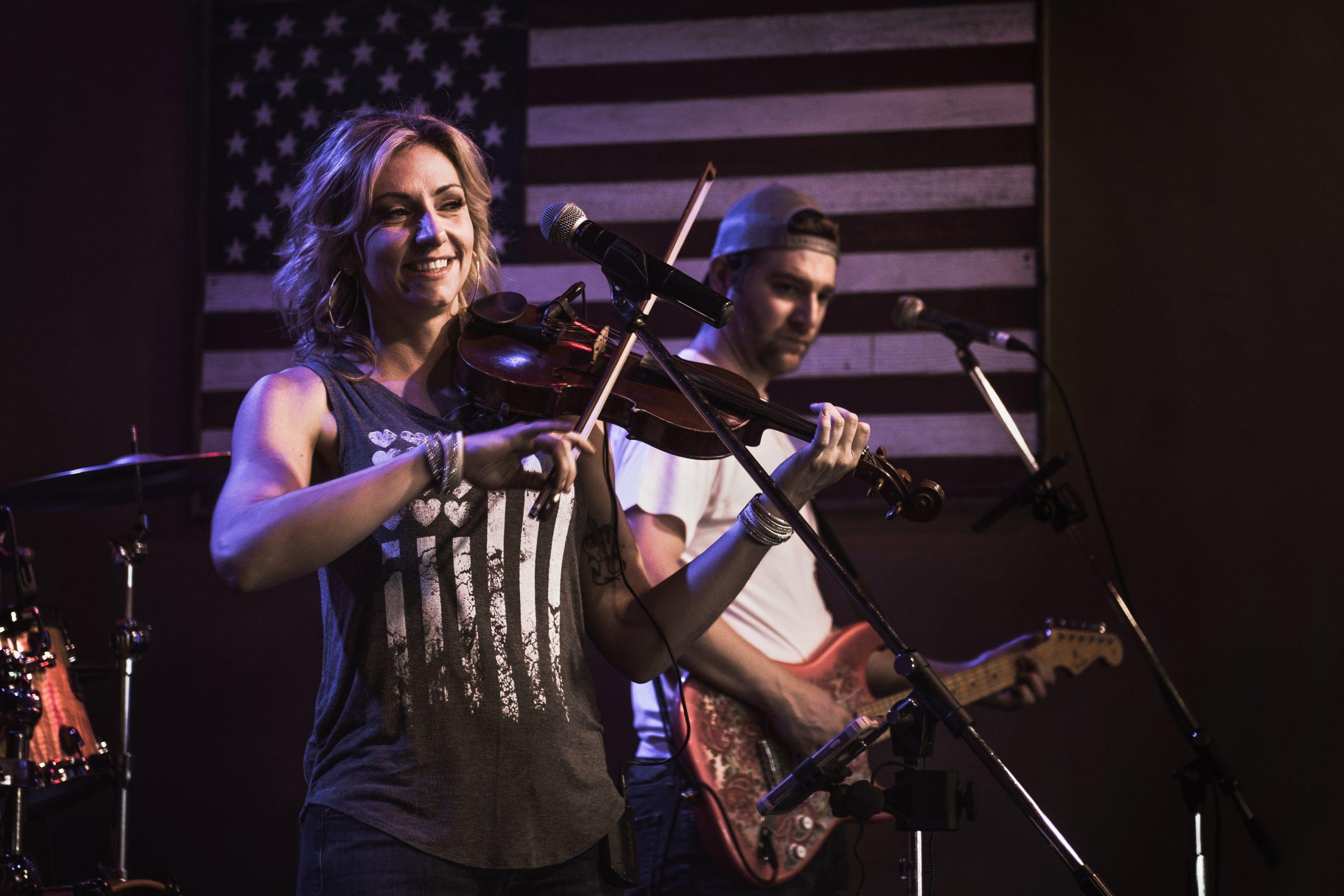 woman performing playing violin