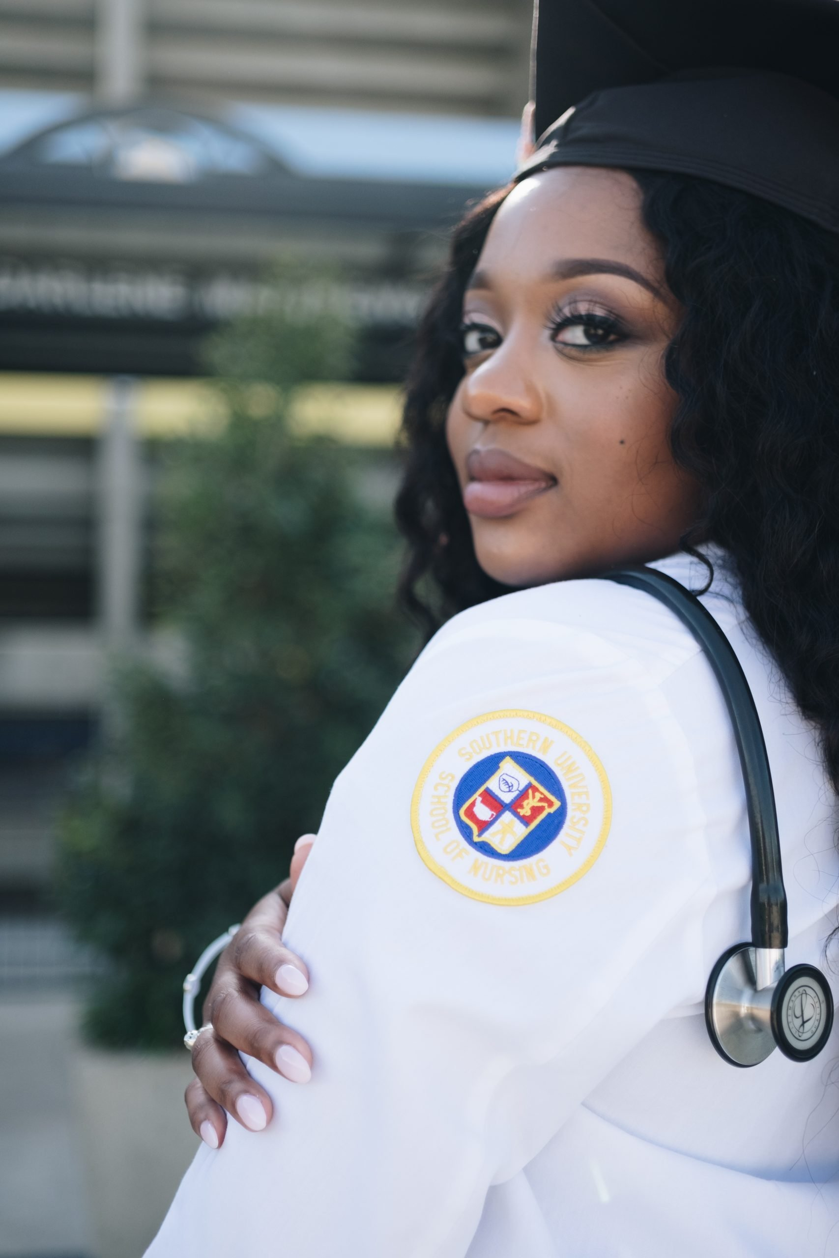 Woman wearing white long sleeved shirt and stethoscope