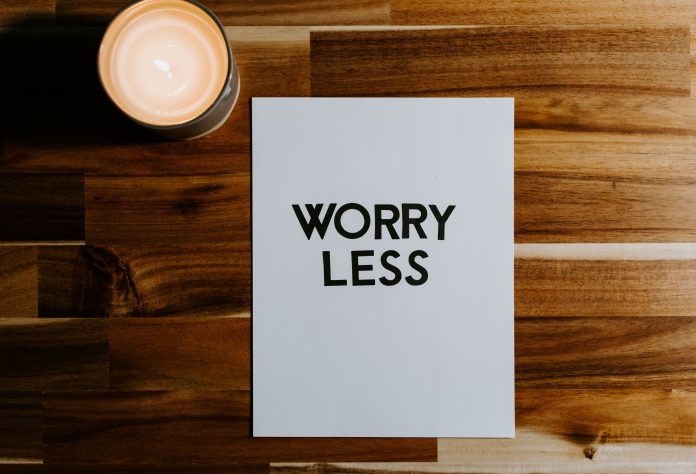 Worry less message on paper with cutout letters